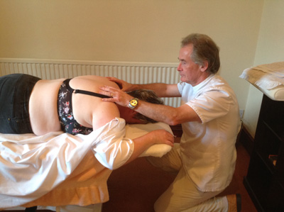 Ian Griffiths Osteopath treating a patient in Bridgend
